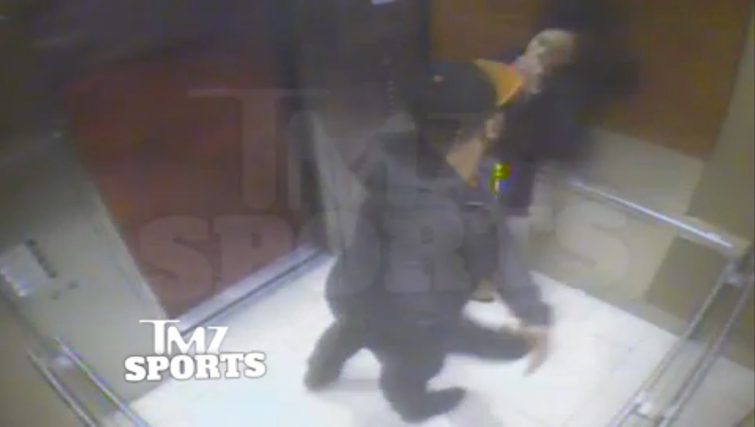 In this February 2014 file photo from a still image taken from a hotel security video released by TMZ Sports, Baltimore Ravens running back Ray Rice punches his fiancee, Janay Palmer, in an elevator at the Revel casino in Atlantic City, N.J. A law enforcement official says he sent a video of Ray Rice punching his then-fiancee to an NFL executive five months ago, while league officers have insisted they didn