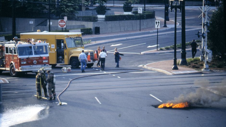 Meriden firefighters at scene of underground power line fire on Perkins Square at Hanover St. May 29, 1994.