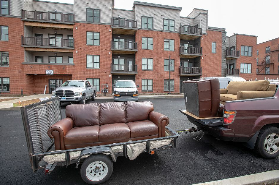 A tenant prepares to move his furniture into the newly constructed Parker Place Apartments in Wallingford, Tuesday, Sept. 11, 2018. Construction is continuing on Parker Place Apartments while the first tenants move in. Dave Zajac, Record-Journal