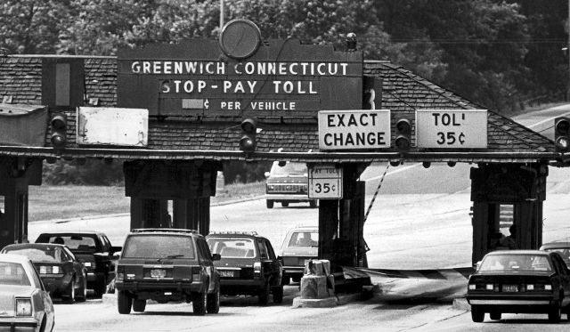 FILE - In this June 1986 file photo, cars travel east bound at the toll plaza on the Merritt Parkway in Greenwich, Conn. A document highlighting aspects of draft legislation to return a form of tolling to Connecticut highways could come up for a vote in the House of Representatives as early as Wednesday, May 2, 2018. (Hearst Connecticut Media via AP, File)