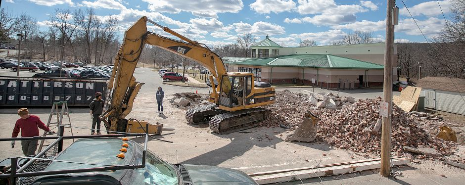 The Civil Defense building, right, next to the Wallingford Senior Center, top, has been taken down by demolition crews, Mon., Mar. 18, 2019. Dave Zajac, Record-Journal