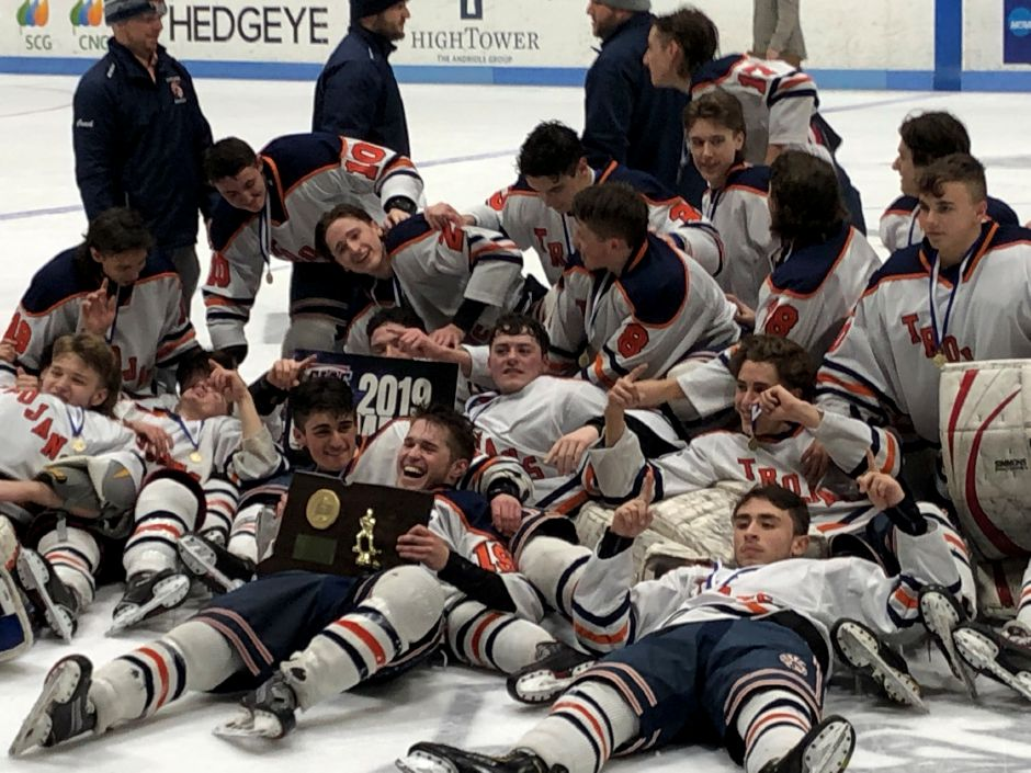 Members of the Lyman Hall/Haddam-Killingworth/Coginchaug ice hockey team bask in the glow a state championship after winning the CIAC Division III final on Thursday night at Ingalls Rink against rival Sheehan, 6-2./Ron Buck, special to the Record-Journal