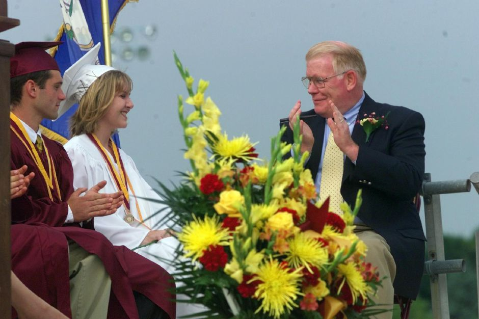 RJ file photo - On the stage during Sheehan High School graduation ceremonies, Brian Howard, left, and classmate Michelle Fabiani, middle, get congradulated by Sean M. Meehan, the school principal, after the two gave their scholar