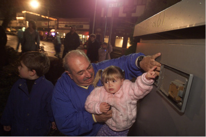 "Julianna Egidio, 3, got to through the switch on all of the Christmas lights on the Southington green with her grandfather Richard ""Jiggy"" Egidio Nov. 11, 2001.  Jiggy is the superintendant of parks for the town."