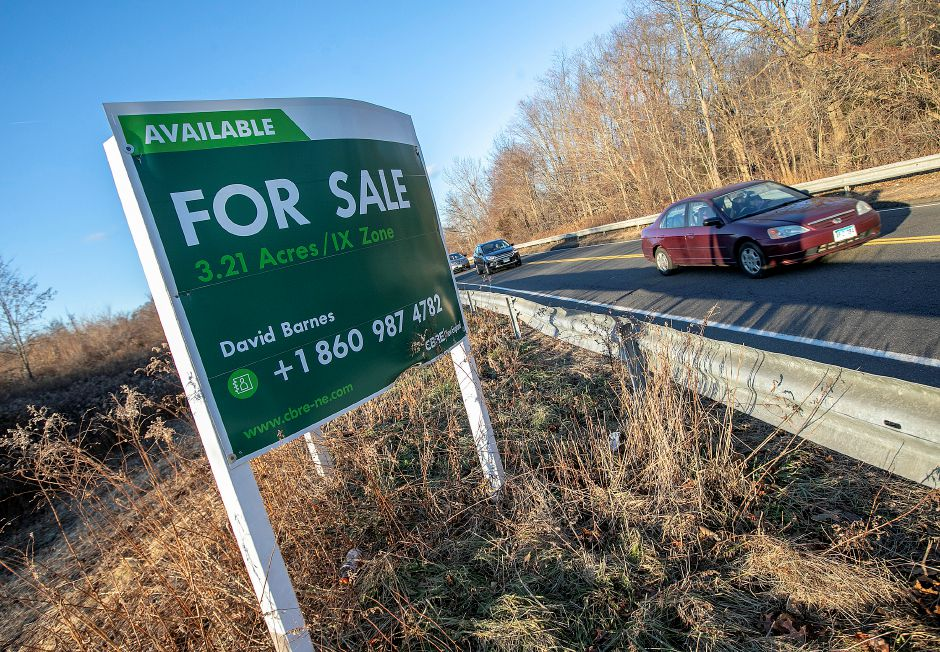 Motorists travel past a land parcel at 6 Research Parkway in Wallingford. A Wallingford car hauling company plans to build. Dave Zajac, Record-Journal