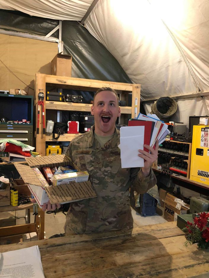 Steven Frauenheim, a 2012 Southington High School graduate, in Iraq last year with some of the 150 Christmas cards he received from St. Dominic Church in Southington | Jim Frauenheim