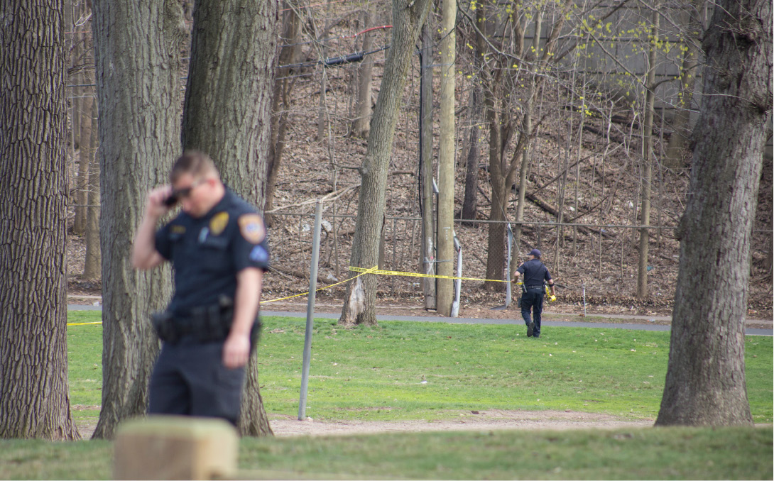 Meriden police investigate a shooting at City Park Wednesday April 29, 2015. | Richie Rathsack/Record-Journal