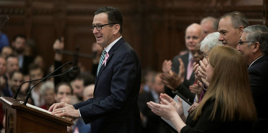 Gov. Dannel P. Malloy receives applause during opening day of the 2018 legislative session in Hartford, Wednesday, Feb. 7, 2018. Dave Zajac, Record-Journal