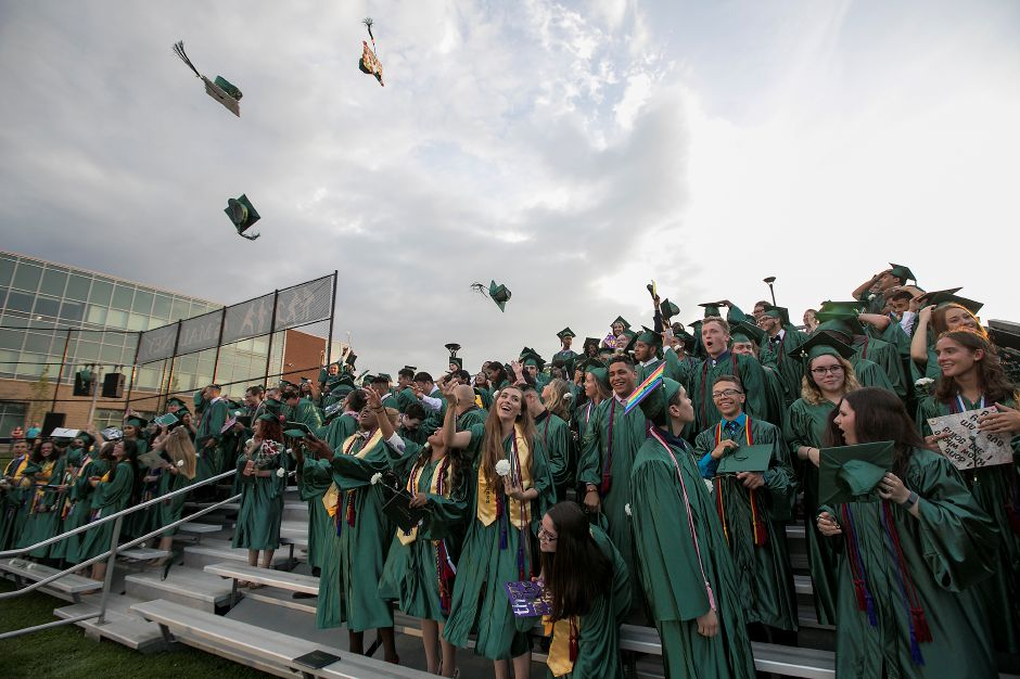 Graduates throw their caps during graduation ceremonies at Maloney High School in Meriden, Tuesday, June 13, 2017. | Dave Zajac, Record-Journal