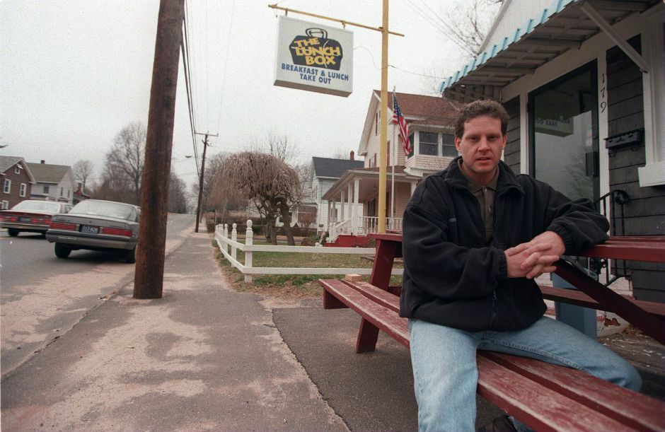 RJ file photo - Steven Langley sits in front of his new business, The Lunch Box, at 179 W. Center St. in Southington, March 1999.