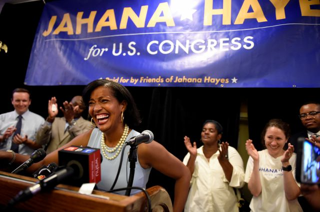 Jahana Hayes wins the Democratic primary for 5th District, defeating Mary Glassman in Waterbury, Conn., Tuesday, Aug. 14, 2018. Hayes, a former National Teacher of the Year recipient, defeated a veteran politician on Tuesday in the Democratic primary for a U.S. House seat currently held by U.S. Rep. Elizabeth Esty, who agreed not to seek re-election amid criticism of her mishandling of a sexual harassment case in her Washington office. (John Woike/Hartford Courant via AP)