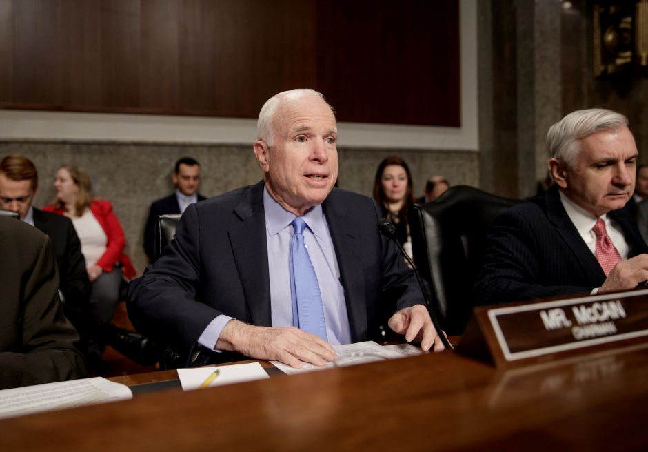 Senate Armed Services Committee Chairman Sen. John McCain, R-Ariz., joined at right by the committee