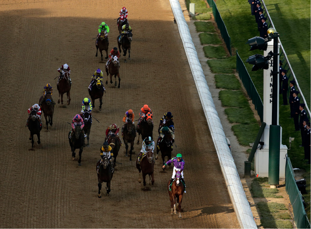 Victor Espinoza rides California Chrome to a victory during the 140th running of the Kentucky Derby horse race at Churchill Downs Saturday, May 3, 2014, in Louisville, Ky. (AP Photo/Charlie Riedel)