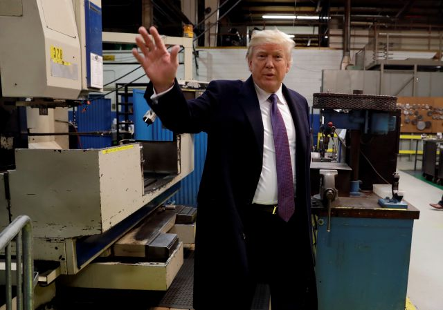 President Donald Trump waves as he participates in a tour of Sheffer Corporation to promote his tax policy, Monday, Feb. 5, 2018, in Cincinnati. (AP Photo/Evan Vucci)