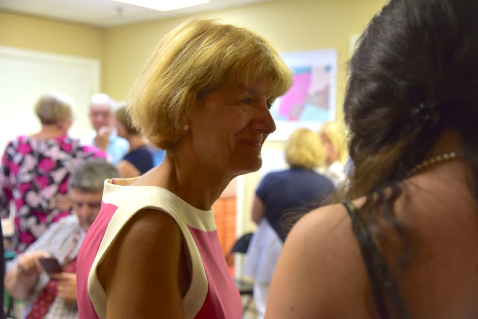 Vickie Nardello awaits results of the 16th Senate District democratic primary on August 14, 2018, while surrounded by supporters in Southington.
