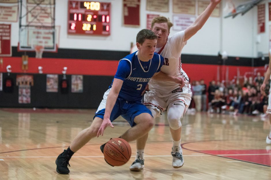 Southington's Ryan Gesnaldo looks to drive past Cheshire's Colby Griffin Friday at Cheshire High School. Cheshire won the game 49-40, ending Southington's eight-game winning streak.