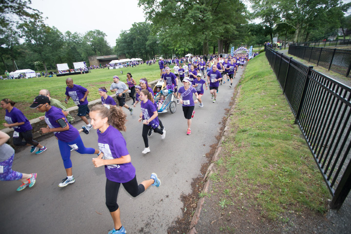 Runners and walkers make their way from the start Saturday during the PurpleStride 5k and walk fundraiser for Pancreatic Cancer Action Network at Hubbard Park in Meriden Jun. 17, 2017 | Justin Weekes / For the Record-Journal
