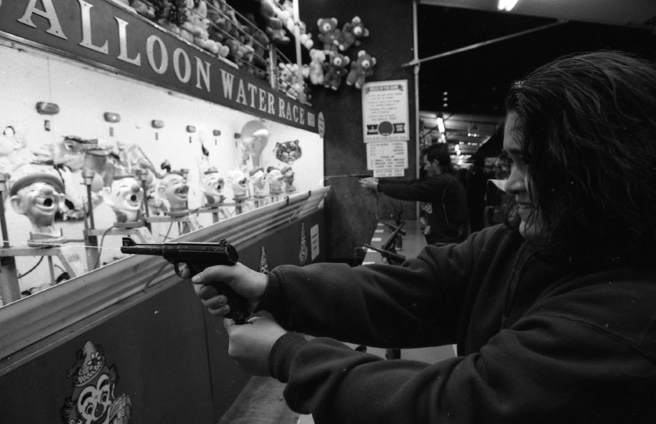 RJ file photo - Festival-goers try their hand at carnival games at the Meriden Expo Oct. 15, 1993.