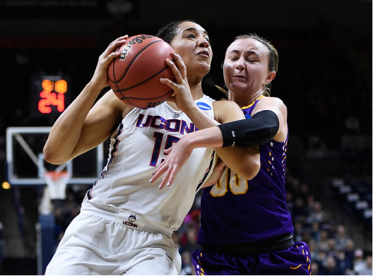 UConn's Gabby Williams is fouled by Albany's Mackenzie Trpcic during the first half of Saturday's NCAA Tournament game in Storrs. | Associated Press