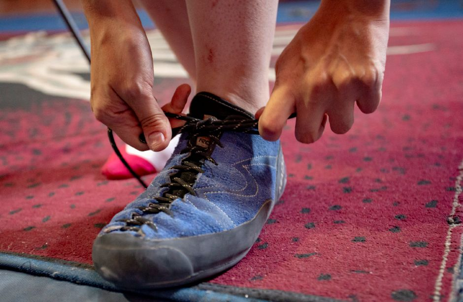 Record-Journal Digital Content Producer Ashley Kus laces up some rock climbing shoes to try out the wall at Prime Climb in Wallingford Aug. 20, 2018. | Richie Rathsack, Record-Journal