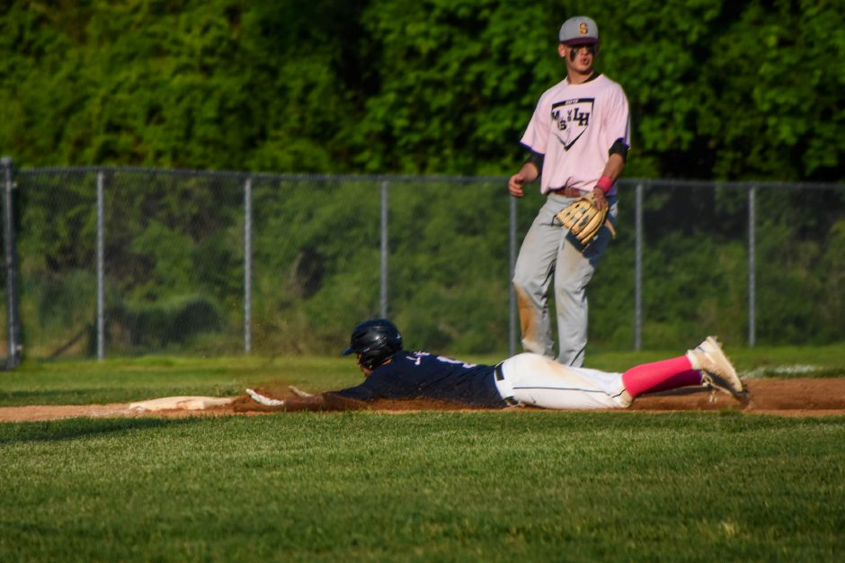 Lyman Halls Jake Ranney slides in safely after stealing third at Pat Wall Field. | Jim McGovern, Special to the Record-Journal