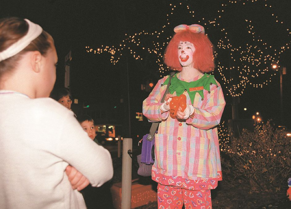 RJ file photo - Valentine the Clown , aka Diana Sheard, entertains people on Hospitality Night in Southington Dec. 4, 1998.