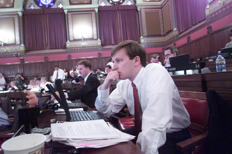 State Rep. Chris Murphy shows some signs of the long hours he has put in at the state house on the last day of the session. It has been a big year for him as a freshman legislator and a law student.