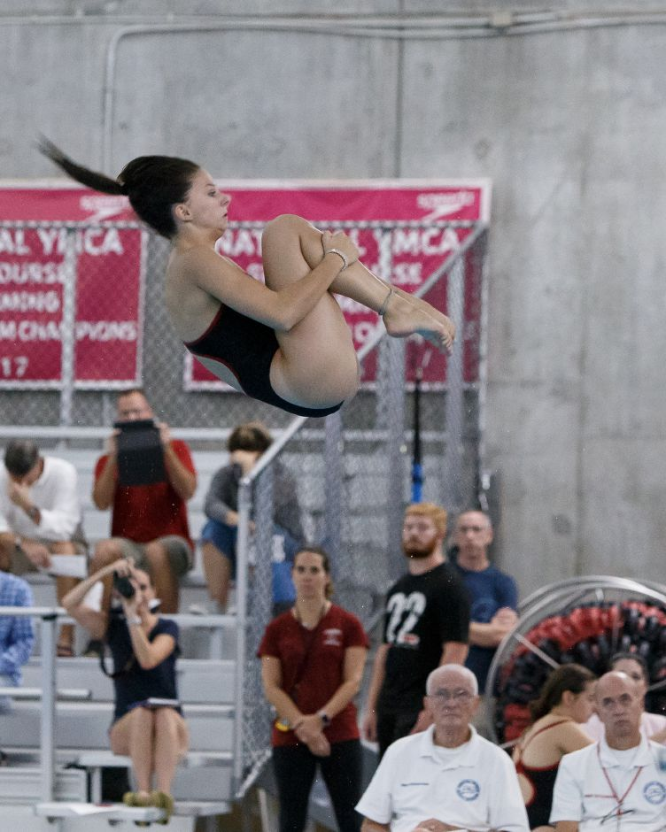 With a score of 285.65 Thursday night at Cheshire Community Pool, Cheshire diver Sienna Breton broke the school six-dive record of 284.55 set by State Open champion Katelyn Cox in 1997.