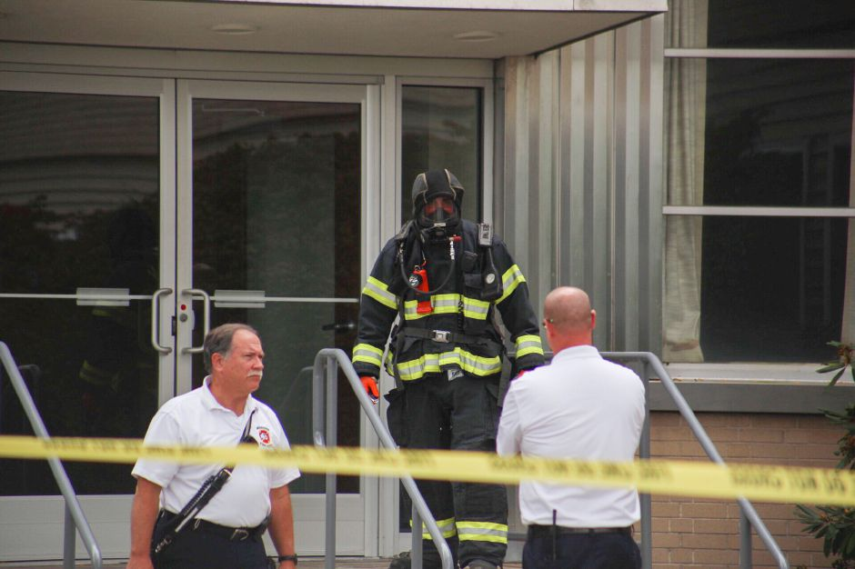 Firefighters investigating the mail room at The Money Source in Meriden. | Richie Rathsack, Record-Journal