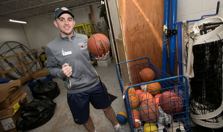 Justin Ferreira, 23, new sports director, stands in the equipment room at the Meriden YMCA, Friday, Jan. 12, 2018. Dave Zajac, Record-Journal