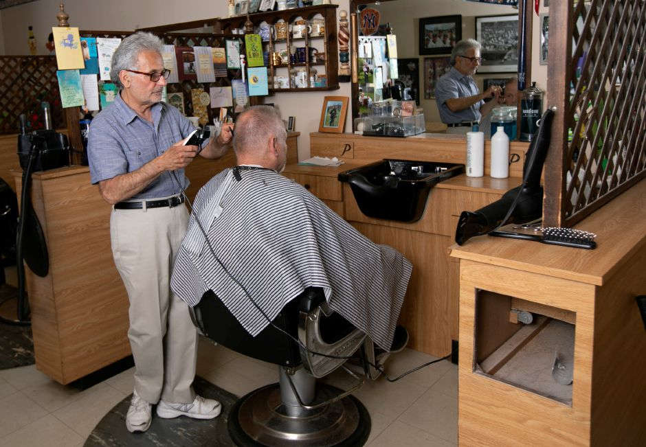 "Barber Prisco ""Pic"" DeLuca gives a haircut to longtime customer Ken Fahey, of Meriden, at Haircraft Hair Salon, 1259 E. Main St. Meriden, Fri., June 28, 2019. DeLuca is retiring and closing the business after cutting hair for 46 years.   Dave Zajac, Record-Journal"