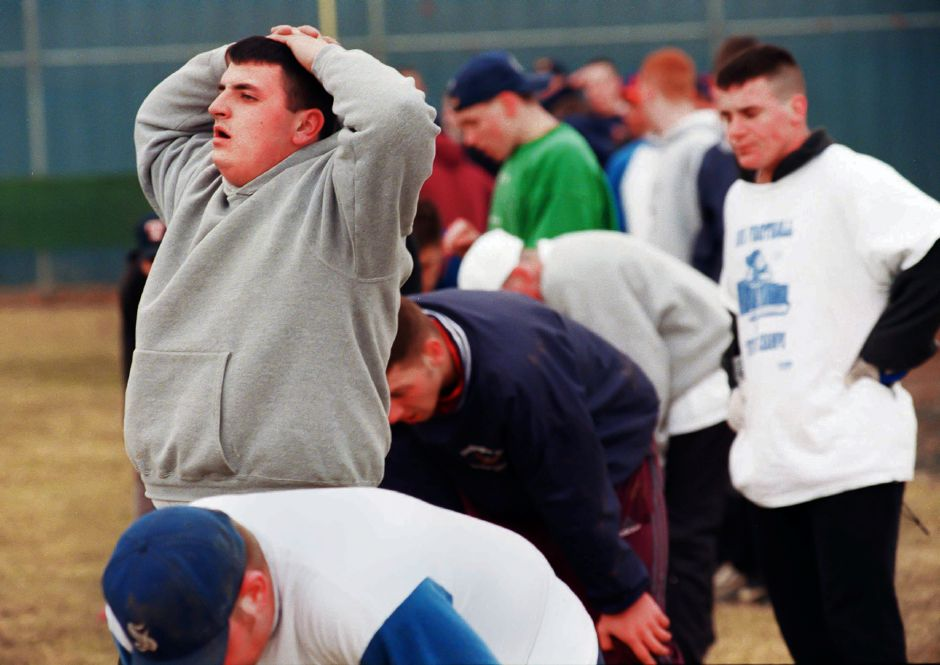 RJ file photo - Tom Valentine, left, catches his breath along with his Southington teammates after running wind sprints at practice March 22, 1999.