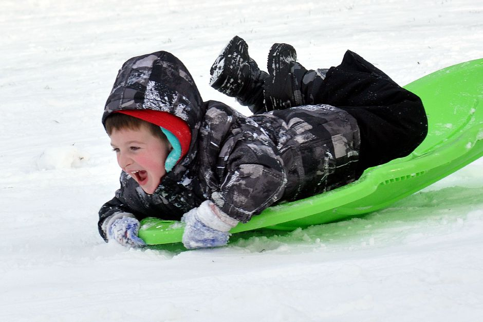 Peyton Appleton-age 5- of Westerly was sledding at Wilcox Park in Westerly after a snow storm on Saturday. (He was with family and friends -ok for photos-no ids on relatives)12-30-2012 photo by Christine Corrigan 1230 ws WILCOX PARK SNOW cc02