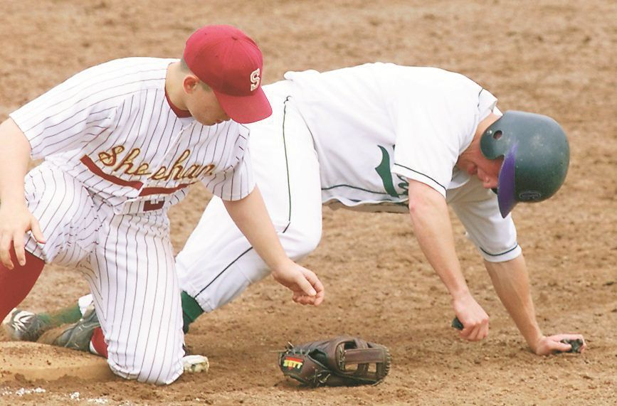 RJ file photo - The ball is in his glove, but Sheehan third baseman Scott Sobkowiak, left, had it knicked off his hand by Guilford