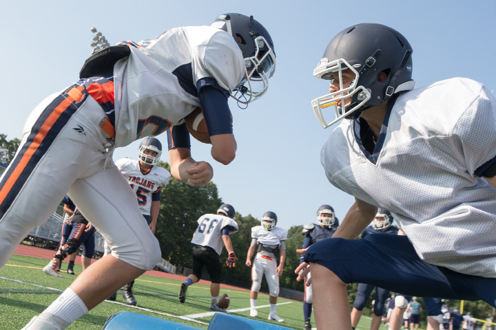 Alex Riccitelli, left, is blocked by Alex Colavito during Lyman Hall football practice. | Justin Weekes / For the Record-Journal