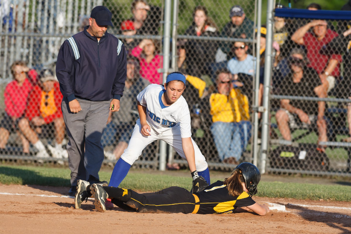 Southington's Kaitlin Paterson (9) tries to pick off Amity's Krista Reynolds-Captain (1) at first Saturday during the class LL final in West haven June,14 2014 | Justin Weekes / For the Record-Journal