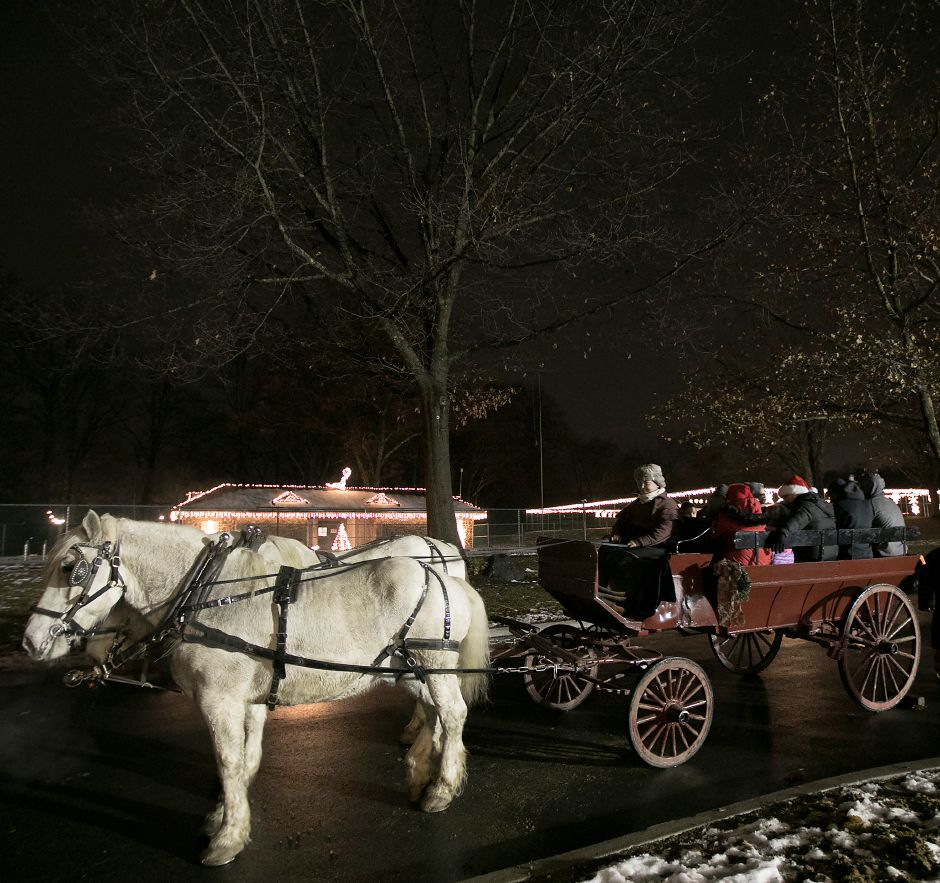 Amanda Roberto, from East Haddam based Allegra Farm, gets set to take passengers on a horse and carriage ride through Hubbard Park in Meriden during Christmas in the Park, Tuesday, Dec. 12, 2017. Percheron horses Little Joe and Zena lead the way. Dave Zajac, Record-Journal