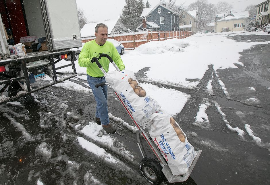Thurston Foods driver Ken Benoit makes a food delivery to Henry's restaurant at 337 N. Colony St. in Wallingford during Tuesday