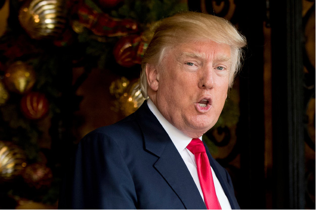 FILE- In this Dec. 21, 2016, file photo, President-elect Donald Trump speaks to members of the media at Mar-a-Lago, in Palm Beach, Fla. Trump is questioning the effectiveness of the United Nations, saying it