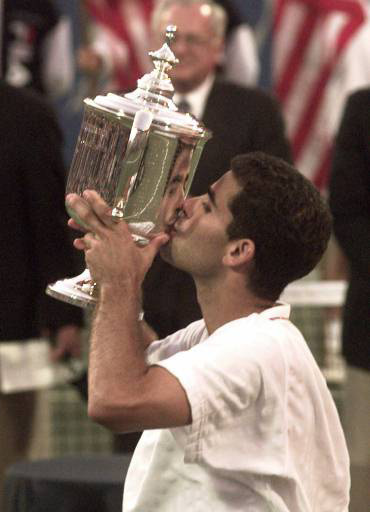 Pete Sampras kisses the U.S. Open mens singles championship trophy after defeating Andre Agassi 6-4, 6-3, 4-6, 7-5 Sunday Sept. 10, 1995 in New York. (AP Photo/Mark Lennihan)