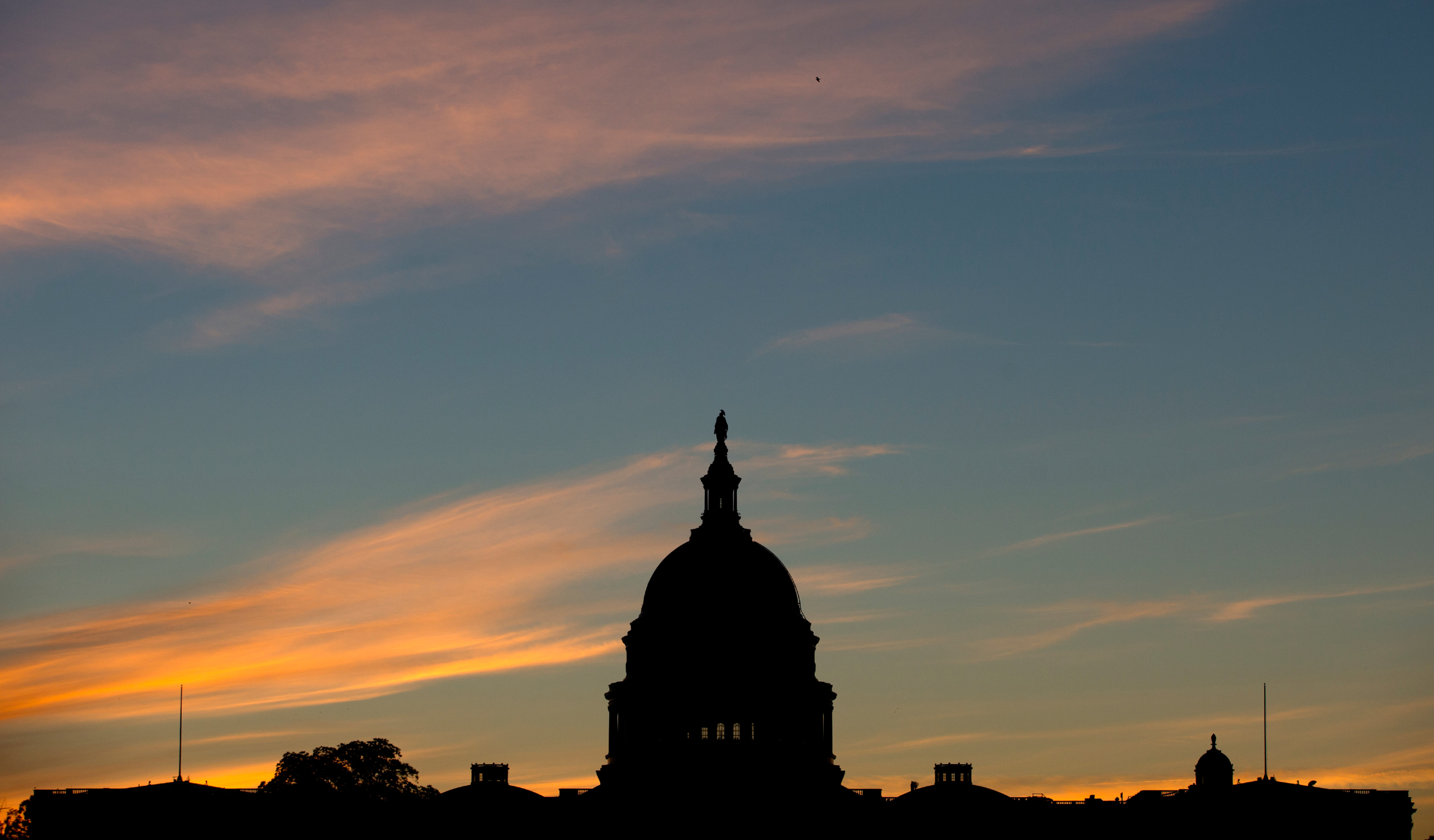 FILE - In this Sept. 15, 2013, file photo, the U.S. Capitol dome is silhouetted by the sunrise. The latest Associated Press-GfK poll holds some ominous signs for congressional Democrats going into the November elections. Overall, people are split between preferring Republicans or Democrats to win control of Congress. (AP Photo/Carolyn Kaster, File)