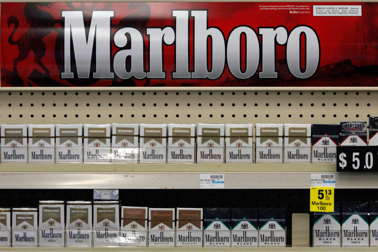FILE - In this Wednesday, July 17, 2013 file photo, Marlboro cigarettes are on display in a CVS store in Pittsburgh. The nation