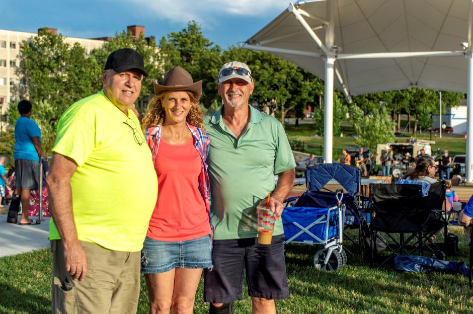 From left, Dave Grodzicki, Carrie Teele and Steve Robichaud, who coordinate and direct the Twilight Music Series along with the city and the local YMCA, pose in front of the amphitheater where Wastin