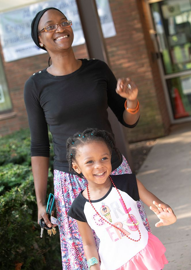Karissa Armstrong, 4, waves to sister Kamilla, 7, with mother Roxanne on the first day of school at Thomas Hooker Elementary School in Meriden, Monday, August 27, 2018. Kamilla