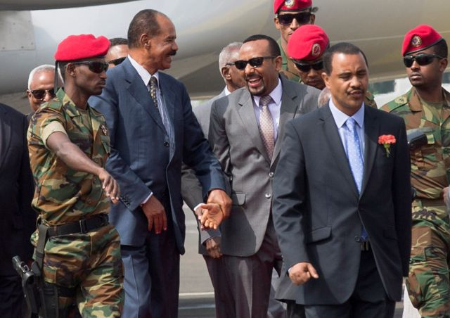 FILE - In this Saturday, July 14, 2018 file photo, Eritrean President Isaias Afwerki, center left, is welcomed by Ethiopia