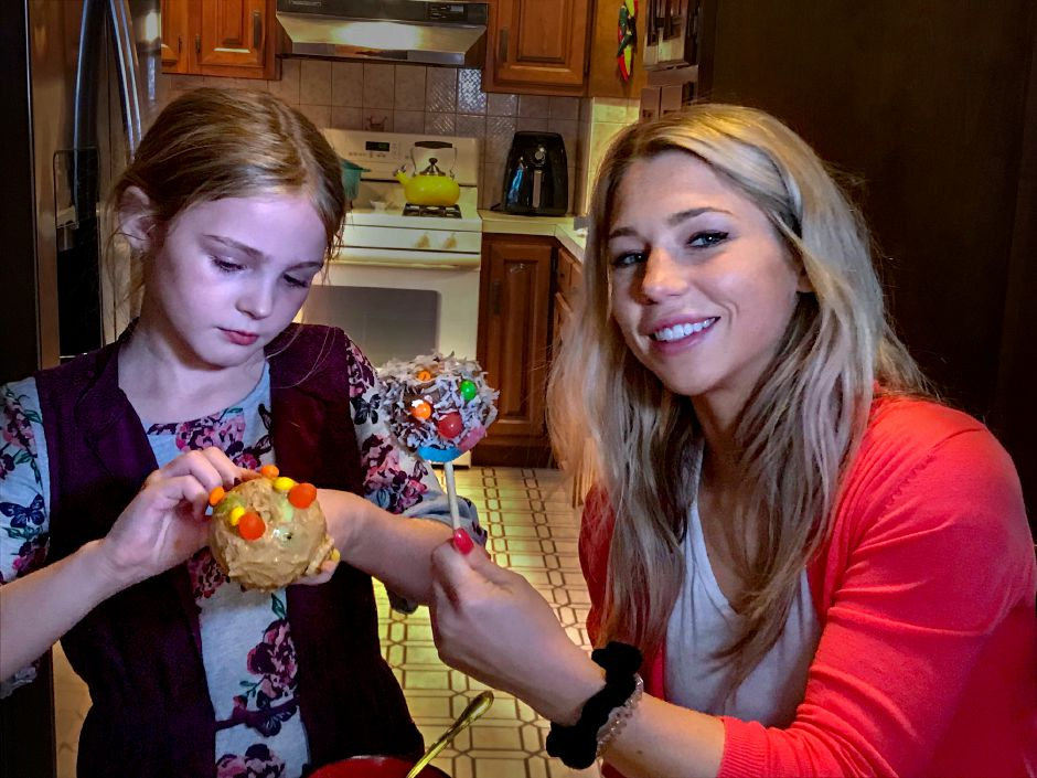 Kristen Dearborn, right, of Wallingford, recently made a healthy alternative to traditional candy apples using Medjool dates with her niece, Lila Yerman, a third-grader at Holy Trinity School in Wallingford. Ashley Kus, Record-Journal