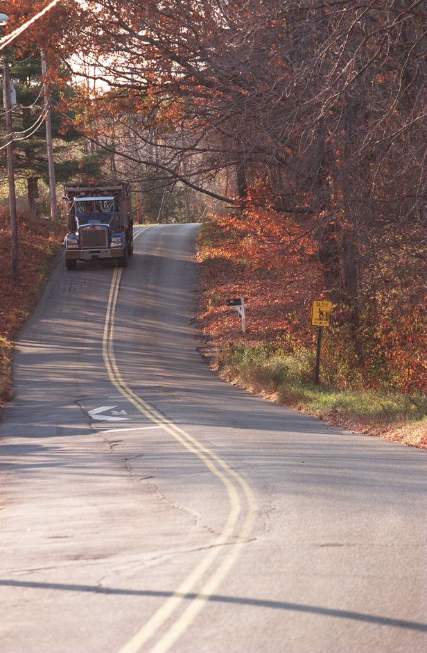 A dump truck ambles down Lazy Lane in Southington in November 1998. The proposed electric power plant would be just to the right.