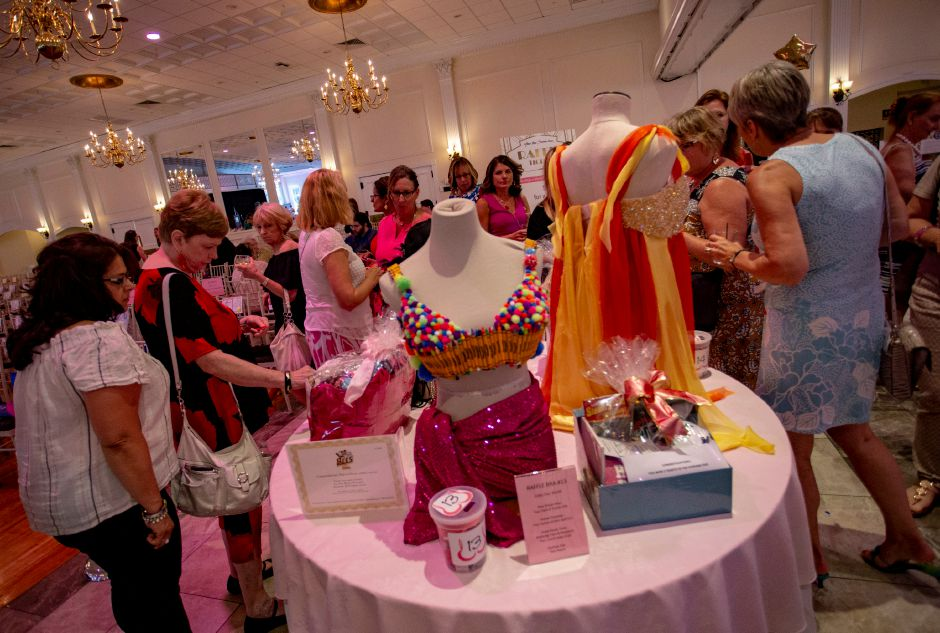 Guests browse through several artistic bras being raffled off at the Art Bra 2018 fundraiser at the Aqua Turf Aug. 9, 2018. | Richie Rathsack, Record-Journal