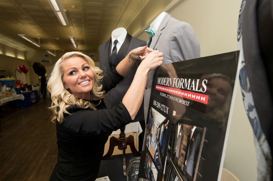 Chrissy Klingenberg of Modern Formals sets her booth up Saturday during the second annual Bridal Expo at the Hubcap in Wallingford February 16, 2019 | Justin Weekes / Special to the Record-Journal