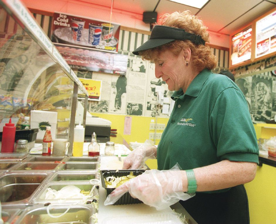 RJ file photo - Patricia Steven of Wallingford makes a salad at the Subway sandwich shop in Yalesville Dec. 16, 1998.